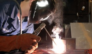 cropped-US_Navy_090114-N-9704L-004_Hull_Technician_Fireman_John_Hansen_lays_beads_for_welding_qualifications-768x449